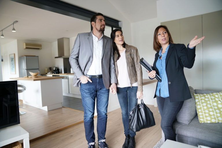 real estate agent with her clients