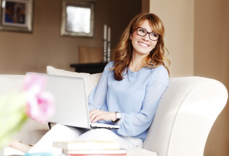 woman working with her laptop on the couch