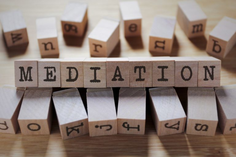 wooden cubes spelling out mediation