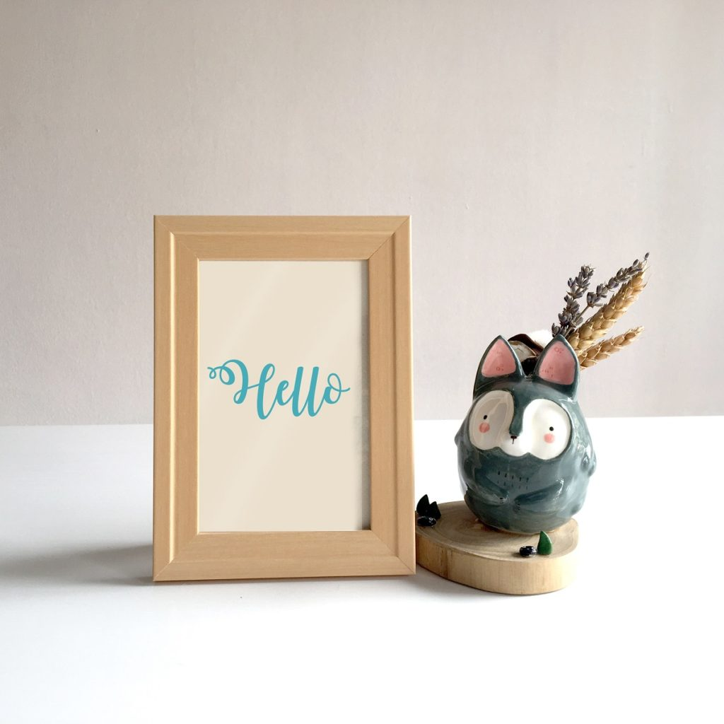 framed paper with hello written in calligraphy
