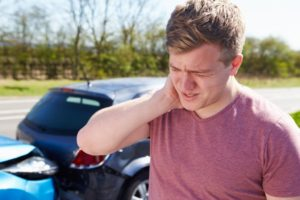 Man with his neck hurting from the accident