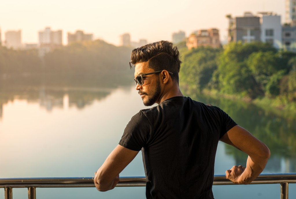 handsome man looking at the river
