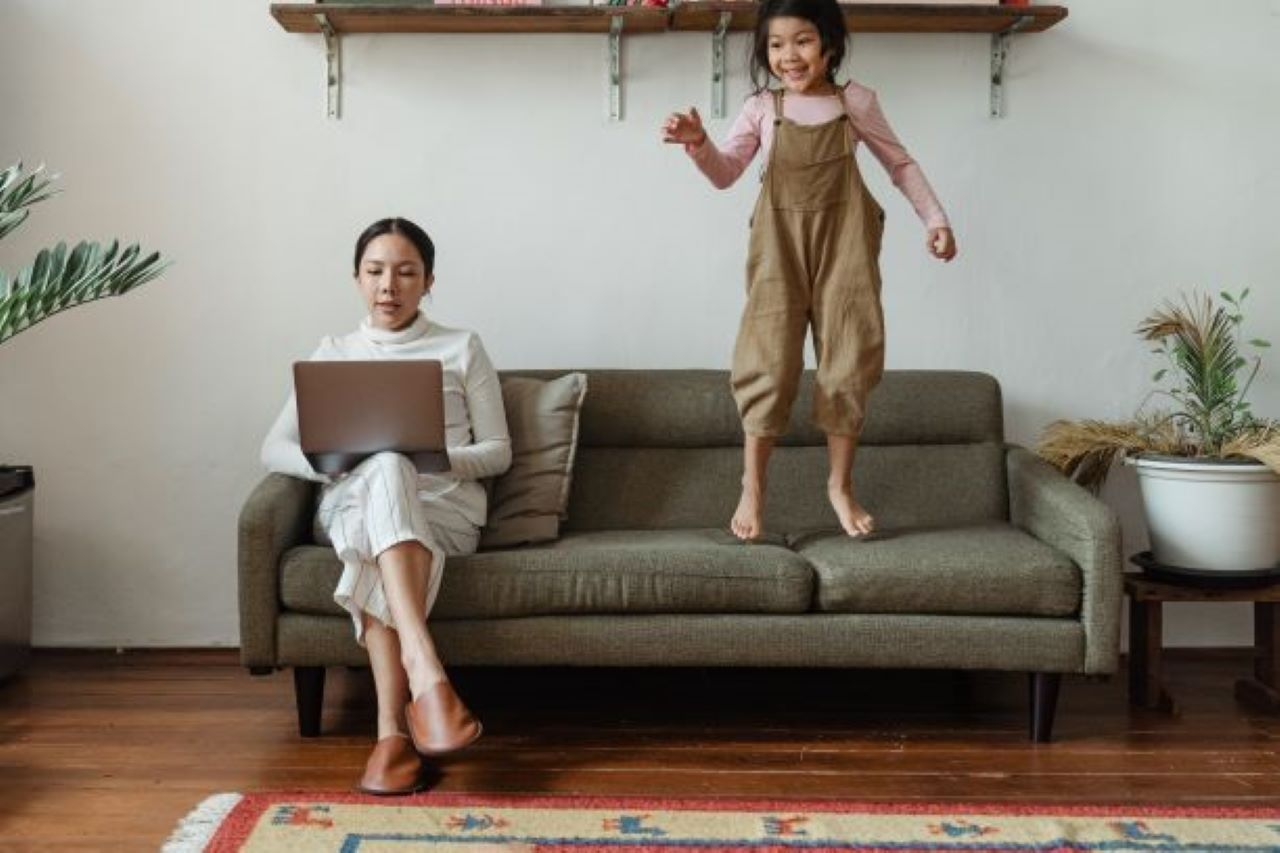 Mom working from home with child